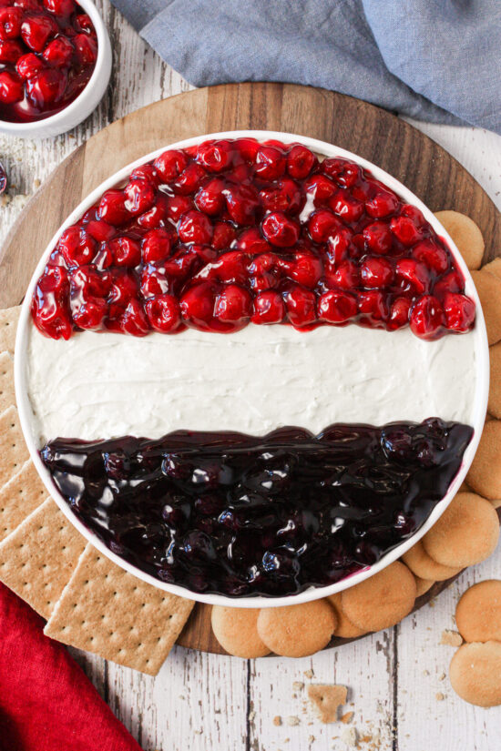 Patriotic Cheesecake Dip with graham crackers and vanilla wafers.