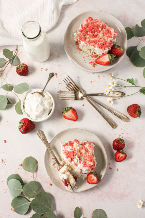 Strawberry shortcake slices on plates with forks.