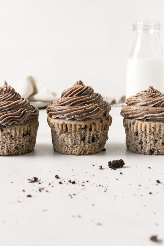 Three cookies and cream cupcakes in a row.
