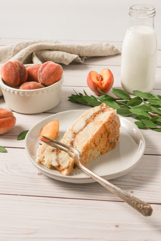 Slice of peach pound cake on a plate with fork.