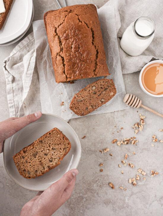 Slice of gluten-free honey walnut bread on a plate.