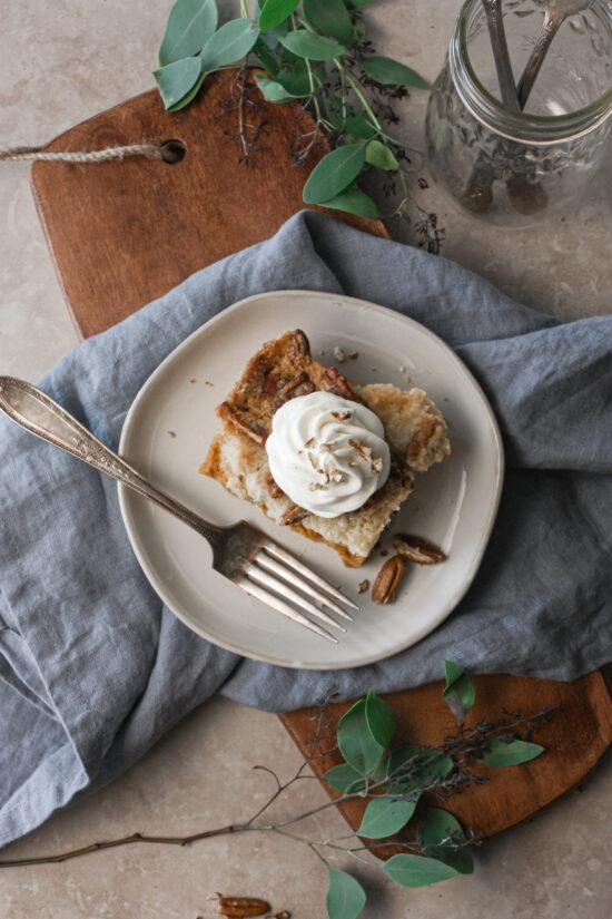 Slice of gluten-free pumpkin pie crisp on a plate with fork.